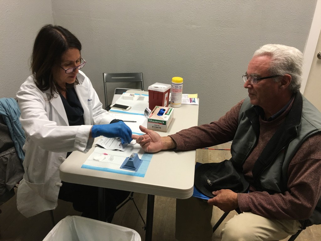 Pharmacy Director Maria Lopez administers the rapid test.
