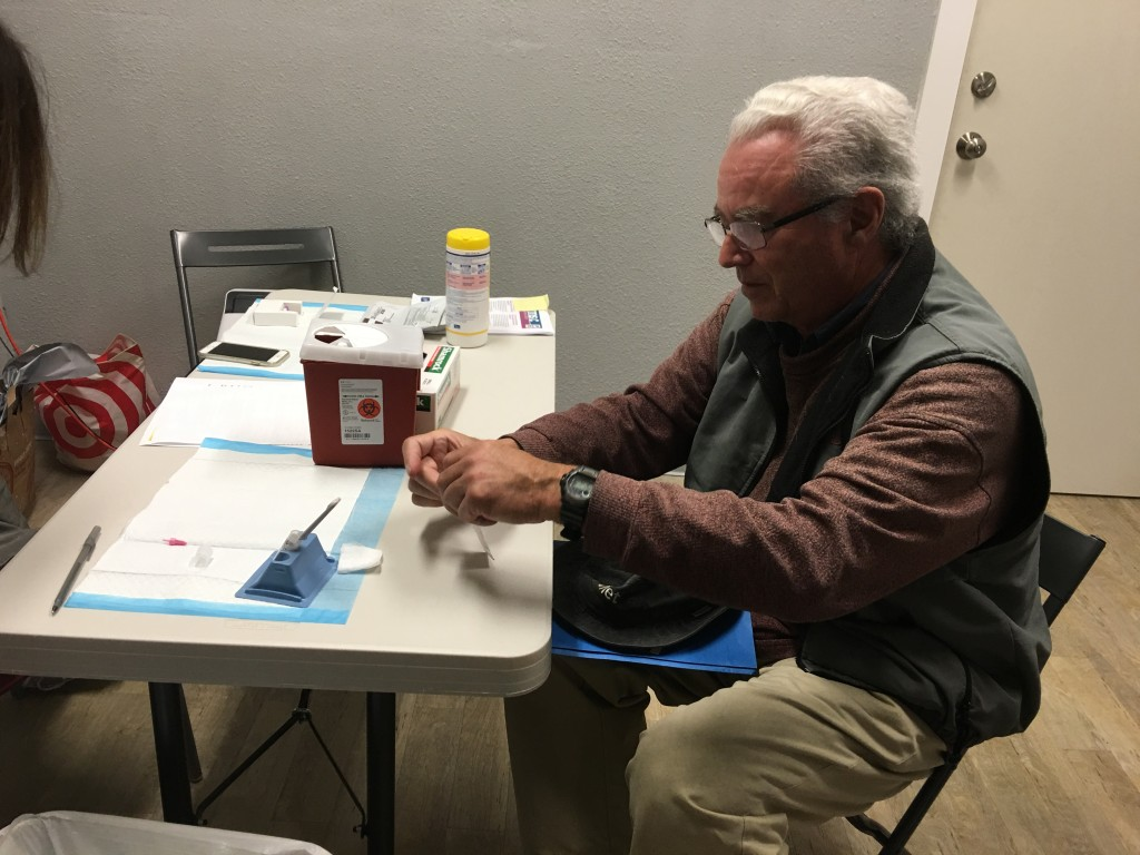 Test over:  Mike uses a sterile pad to clean his finger.